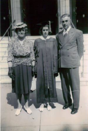 Mary Roberts Lefebre and husband Adolph with daughter Geraldine at high school graduation, 1942.