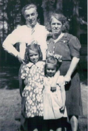 Mary Roberts Lefebre and husband Adolph with daughters Ann (left) and Pam, late 1930s.