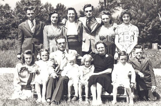 Joseph Allard and wife Alice (seated), other children including Rolland (arm on Dad's knee), 1942.