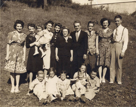 Joseph and Alice Allard (standing in middle), with children and other family members. Son Rolland seated at left. Photo taken in 1944. This and the family photos on the next page provided by Rolland Allard.