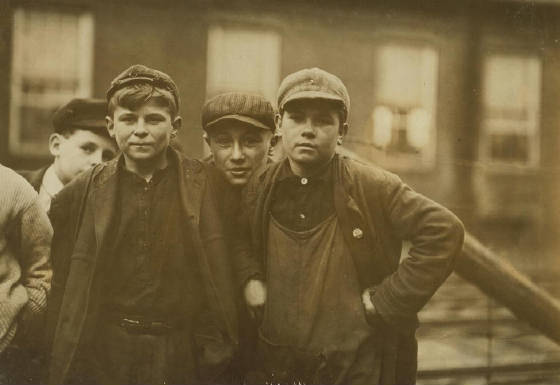 Andrew Stefanik, (on right hand). Arthur Asslin, (on left) 118 Front St. Been working here one year. May be 14 or 15. Location: Chicopee, Massachusetts, November 1911, Lewis Hine.