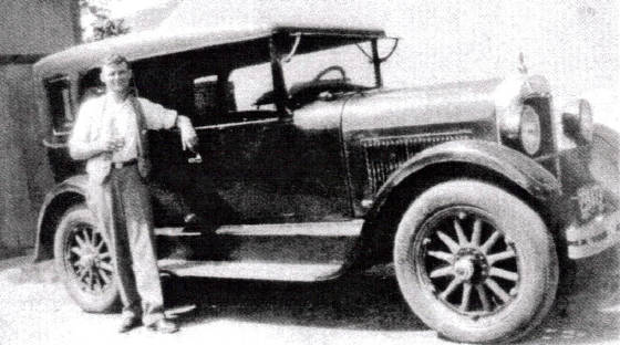 Arthur Asselin with his first car, date unknown. Photo provided by family.
