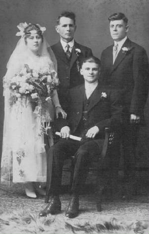 Wedding day (1920): Arthur (seated), Matilda, her father, and Arthur's brother. Provided by family.