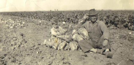 Ben Karst (Jacob Rommel's son-in-law) and son Jim, sitting by beet piles, 1941