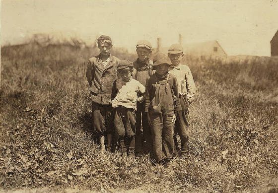 Byron Hamilton (front left) & brother George (rear left), Eastport, Me, Aug. 1911. By Lewis Hine.