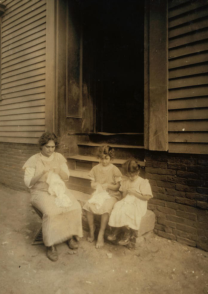 Carmina Caruso (center), mother Marie & sister Mary, Somerville, MA, Aug 1912. Photo by Lewis Hine.