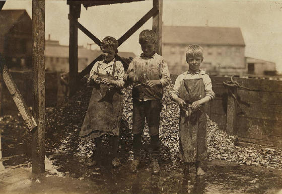 Clarence (left), 8 years old, & George Goodeill (ctr), 11 years old. Photo by Lewis Hine.