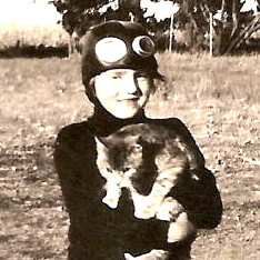 Claudine wearing aviator helmet, probably inspired by Amelia Earhart, late 1930s