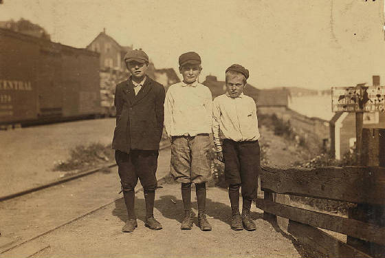 Daniel Collins (right), 11 years old, Eastport, Maine, August 1911. Photo by Lewis Hine.