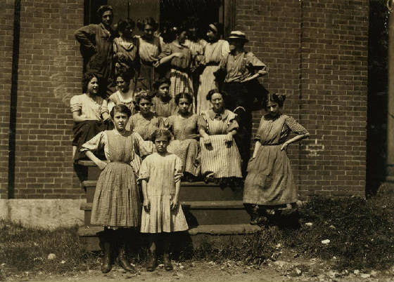 Mary (small child in front), 11, & Dora Roberts (2nd row, 2nd from left), 19, Winchendon, MA.