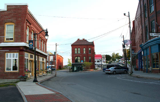Downtown Eastport. Building illuminated by sunlight is former American Can Co, on Sea Street.