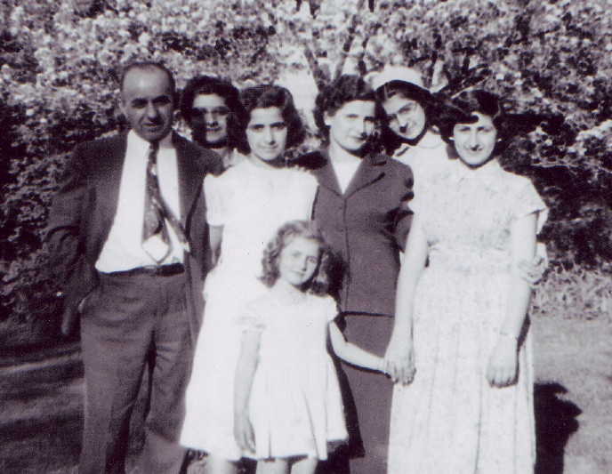 (L-R) Elias Joseph, daughters Elaine and Madeline, wife Eugenie, daughters Joanne (wearing glasses) and Genevieve, and youngest daughter Bernadette (in front). Photo taken in 1950, and provided by family.