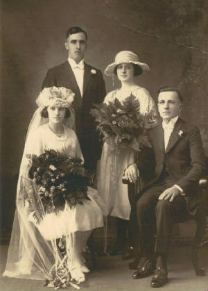 Evelyn Casey and Alfred Simonetti (seated) on wedding day, Sept 18, 1922. Photo provided by family.