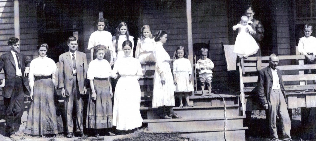 Childen pictured left to right: (front row): Rufus, Annie, George, Emma, Ella; (back row): Bird, Mary, Mamie. Girl standing sideways is Ada, small girl in center is Fannie, small boy in center is Clyde, and boy standing at far right is Bill. Baby is Lela, mother is Martha, and father is James.