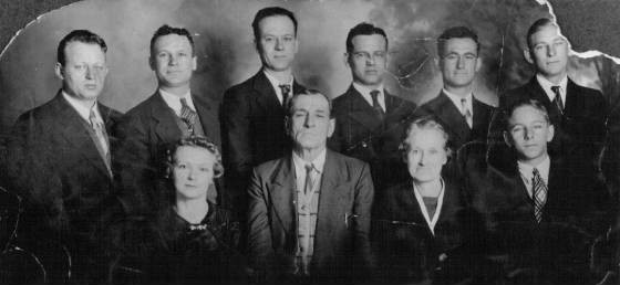 Kirkpatrick family, about 1936. Back row (L-R): Otis, Edward, Vonnie, Ertle, Arvie, Frank; front row (L-R): Dovey, Lige, Ida, Everett.