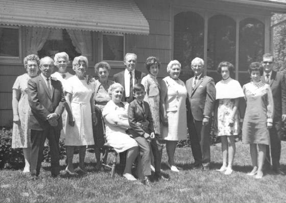 Omer Payette (Eglantine's husband), second from left; Odella Laberge Doyle, third from left; Eglantine Laberge Payette, fourth from left); Agnes Laberge Bessette, seated with Keith Lenkowski, grandson of Eglantine; Susan Lenkowski (granddaughter of Eglantine), standing behind Keith; Mamie Laberge Mossey, next to Susan; Frank Mossey, next to Mamie; Karen Lenkowski (granddaughter of Eglantine), next to Frank; Marguerite Payette Lenkowski (Eglantine's daughter), next to Karen. 1967