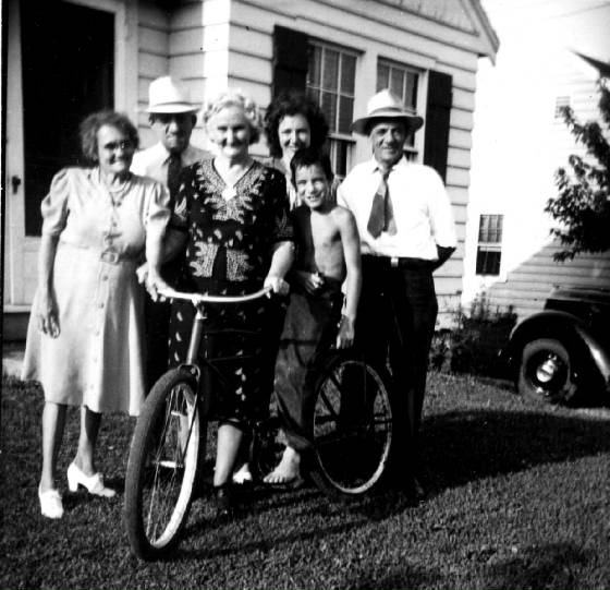 (L to R): Glovinia Watson, husband Frank Watson (Luther's brother), Luther's wife Mabel (on bike), daughter Goldie Mae Watson Hinkle, Homer Hinkle (grandson of Luther and Mabel), and Luther Watson. Photo taken in the 1940s.