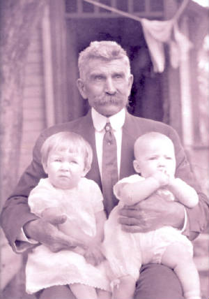 Howard Butcher with Joseph Manning (baby on viewer's right), 1912