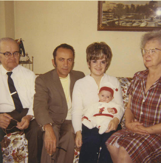 (L-R): Irenee Laprise, son Marc Laprise, granddaughter Marguerite Insco with her baby Jeff, and wife Lucienne Laprise. February 1971. Photo provided by family.