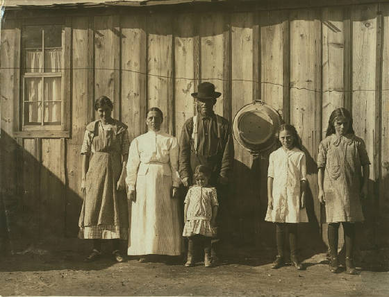 (L-R) Elizabeth, Alice, Jacob (with hat), Martha (front), Lydia, and Molly Rommel, by Lewis Hine