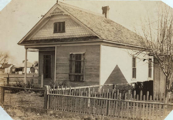 Jacob Rommel home in Ft. Collins, Colorado, October 30, 1915. Photo by Lewis Hine. Rommel home, 430 N. Loomis St., Ft. Collins, Colo. Home boarded up for six months this year while family lived in the little shack shown in 4040. Location: Ft. Collins, Colorado / Photo by Hine 10/30/15.