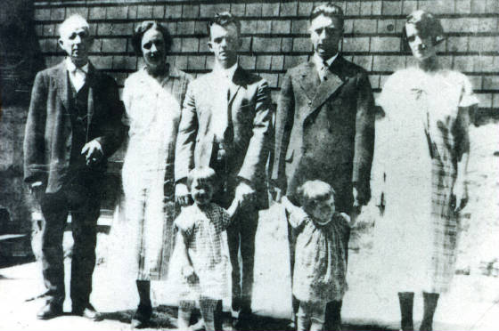 (L-R): Thomas Roy (Isabella's father), Isabella Roy Durette, husband Peter Durette, and Isabella's sister Jeanette (right). Others not identified. Date unknown. Photo provided by family.