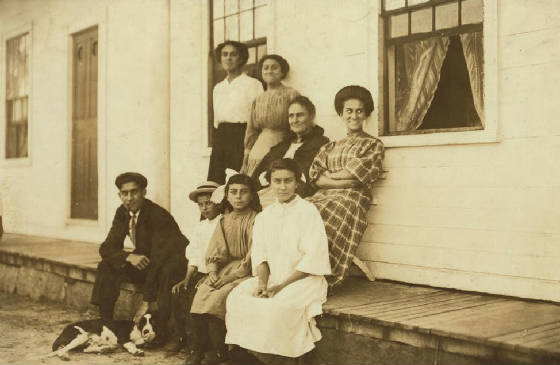 Henry (with dog), Francis [Frank] (wearing hat), Odella (next to Francis), Mamie (next to Odella), Josephine (standing at left), Eglantine (next to Josephine), mother LaRose (seated next to Eglantine), and Louise.