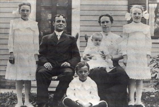 Eugene and Lucy with daughters Pearl (L), Blanche (R), sons Earl (baby), and Raymond, 1912.