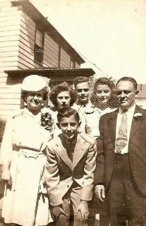 1944 photo provided by family. Boy in front is Harold Basch (son in the interview). Back row (L-R): Dora Nevins, children Gloria, Herbert and Bernice, and husband Frank on the right.
