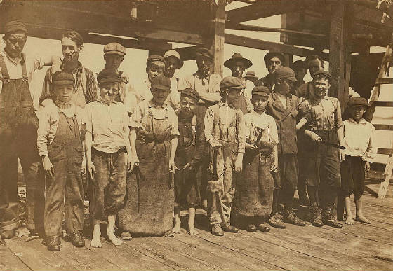 Richard Mills (small boy in center of front row), Eastport, Maine, August 1911. Photo by Lewis Hine.