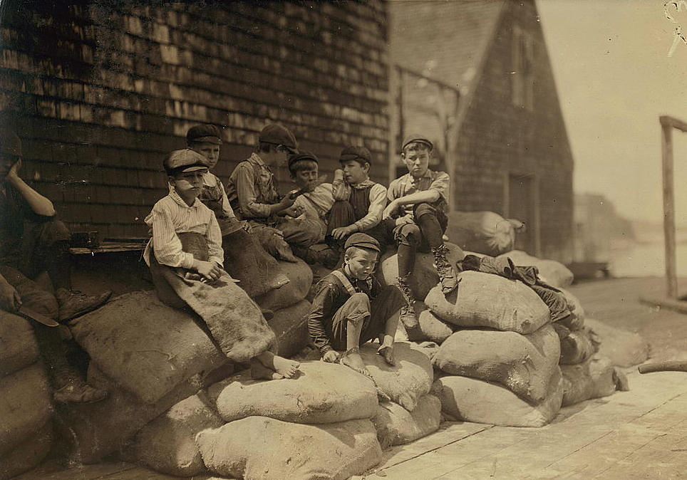 Richard Mills (sitting below others), Eastport, Me, Aug 1911. Photo by Lewis Hine.