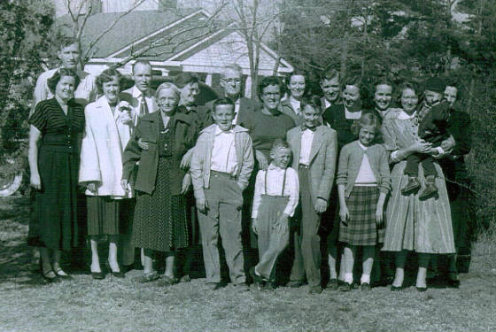 Sadie Barton Howard and husband James, (third and fourth from left in back row) with family