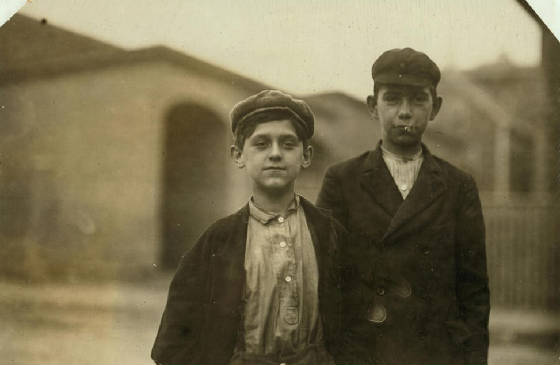 Adelard Gagnon (left), 14 yrs old, 32 Perkins St (not Palmer), Salem, MA, Oct 1911. By Lewis Hine.