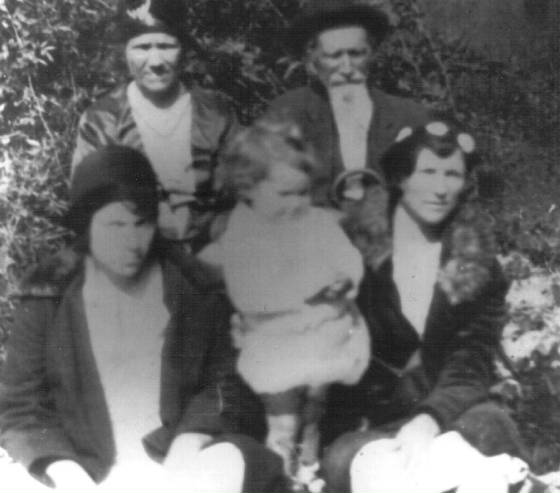 Back row: Catherine Bailey Young and her father Seaborn Bailey; front row: Catherine's daughter Mattie Young Ricks (right), Mattie's daughter Ione Ricks Patterson (left), and Ione's daughter Kathelene Patterson (middle).