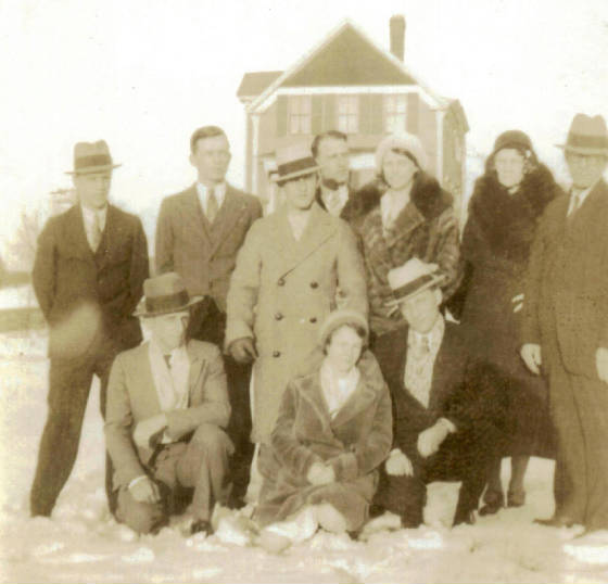 Eva with her parents and siblings in front of their house at 61 Sylvester Street, circa 1940. Left to right (standing): Edward, John, Arthur, Romeo, Eva, Roseanne (mother), Joseph (father); (kneeling): Alfred, Jeannette, Paul.