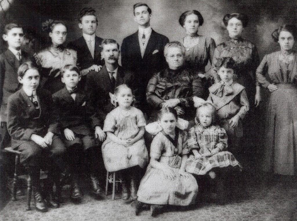 Top row (L-R): Adelard, Alma, Emile, Napoleon, Alexina, Elise, Rosanna. Second row (L-R): Omer, Norbert, Elie (father), Adele (mother), Amedee. Bottom row (L-R): Leocadie, Malvina, Irene.
