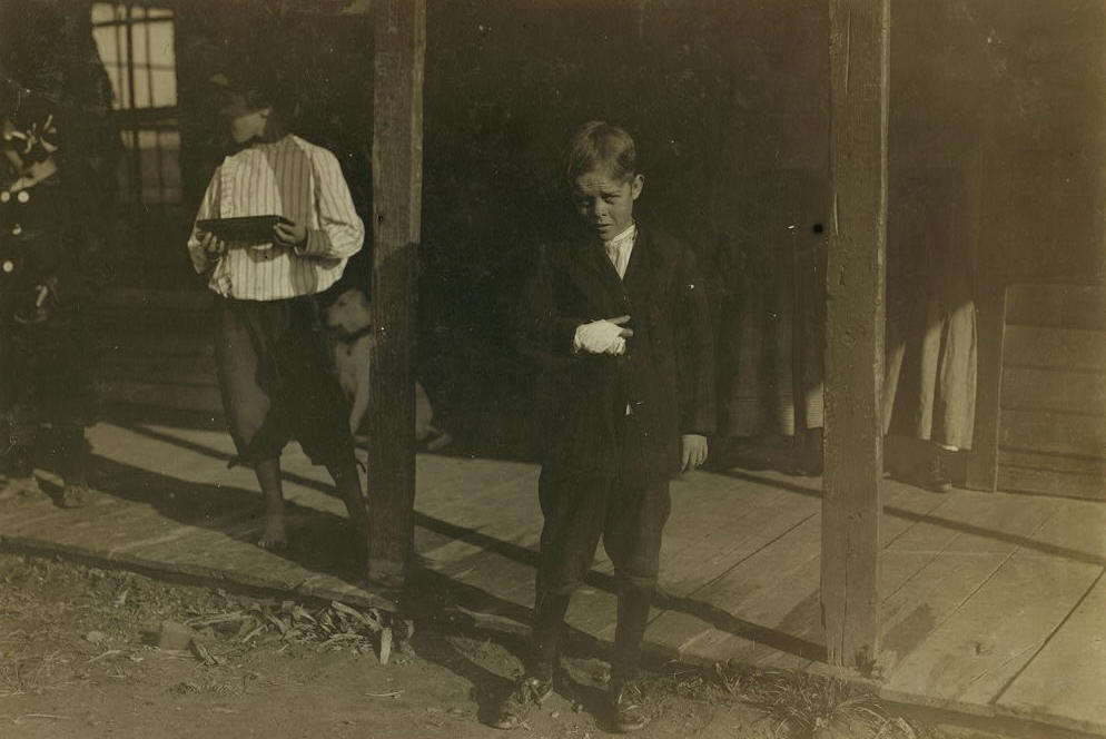 Giles Newsom, and brother Barney (left), Bessemer City, NC. Photo by Lewis Hine.
