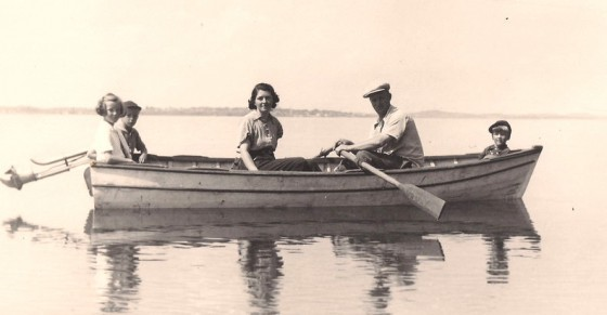 Grayson Forsyth (rowing) with (L-R): daughter Dorothy, son Grayson, wife Mary, and son Richard. In the background is the Franklin Roosevelt cottage on Campobello Island. Photo taken in 1939.