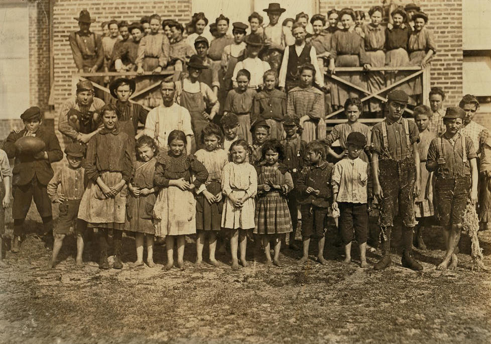 The whole force, Tifton Cotton Mill, Tifton, Ga. All these were working and helping regularly in the mill. Location: Tifton, Georgia, January 1909, Lewis Hine.