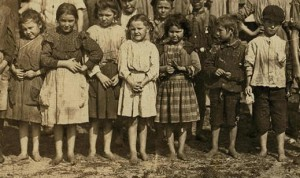 Children of the Young family. In front row: Mary (far left), Mattie (third from left), Eddie Lou (fifth from left), Elzy (sixth from left), and Alex (far right). Other two children are not members of the Young family. The oldest sister, Mell, is not in the picture. She might have been home taking care of Seaborn, Elizabeth and Jesse.