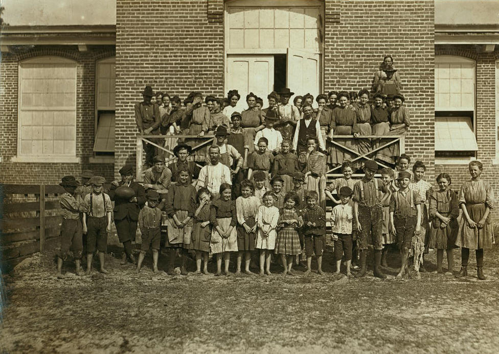 Workers in the Tifton (Ga.) Cotton Mills. All these children were working or helping. 125 workers in all. Some of the smallest boys and girls have been there one year or more. Location: Tifton, Georgia, January 1909, Lewis Hine.