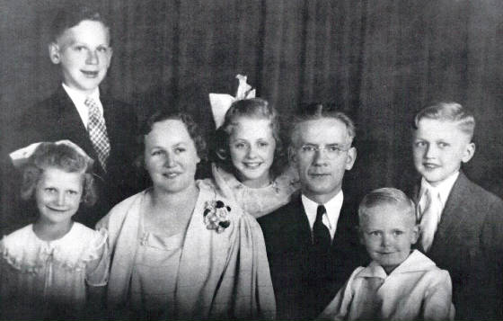 Endyke family. (Front L-R): Louise, Mary (mother), Rita, John (father), Walter, Francis; John J. standing in back at left.