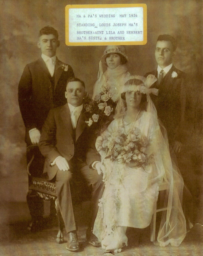 Julia with husband Domenic Tuliano (both seated) on their wedding day. Photo provided by family.