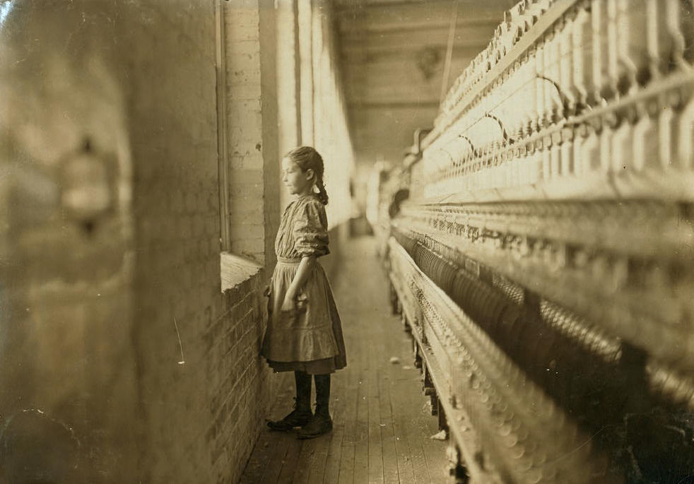 Rhodes Mfg. Co., Lincolnton, N.C. Spinner. A moment's glimpse of the outer world. Said she was 10 years old. Been working over a year. Location: Lincolnton, North Carolina, November 1908, Lewis Hine