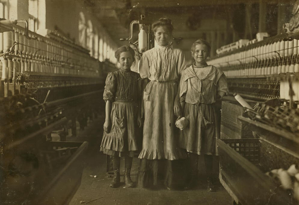 Rhodes Mfg. Co., Lincolnton, N.C. National Child Labor Committee. Girl on left said she was 10 years old and been in mill a long time more than a year. Spinner girl on right said she was 12 years. Location: Lincolnton, North Carolina, November 1908, Lewis Hine.