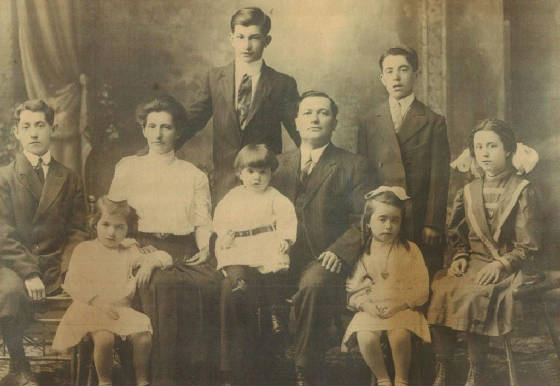 Napoleon Camire (standing in back in the middle), with his parents and some of his siblings.