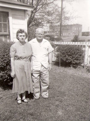 Selena and Maxie Barefield at their home. Oil mill where Maxie worked is in background.