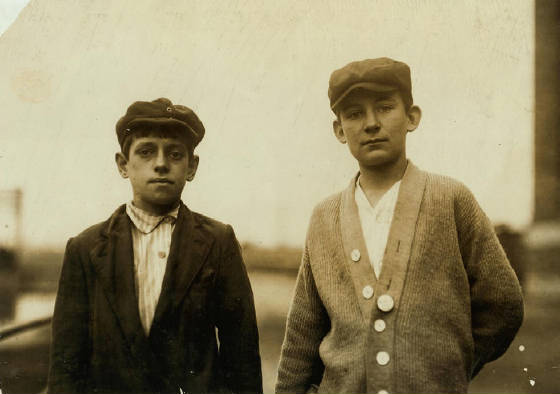 Wilfred Valliere (right), Thomas Levesque (left), 15 yrs old, Lawrence, Massachusetts, September 1911. Photo by Lewis Hine.