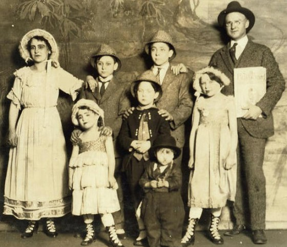 Capps Family, 1917. Photo by Lewis Hine. (L-R): Back row: Pearl (mother), Earl, Kendall, Edward (father); middle row: Bridget (Bee), Edward Jr., Edith; front: Orville.