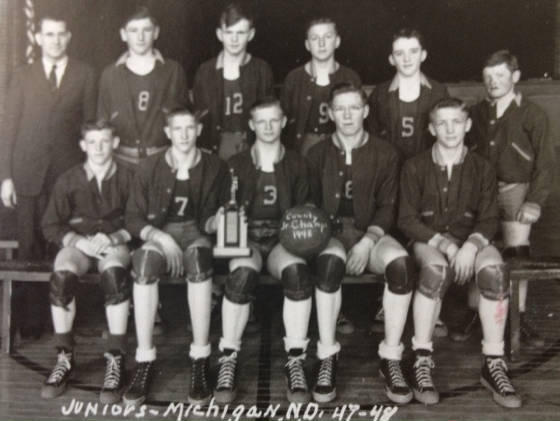 Charles Thompson on basketball team (back row, wearing No. 12), 1948.